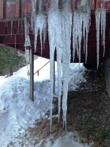Here's a look at the icicles under the porch. Note wind chimes on left.