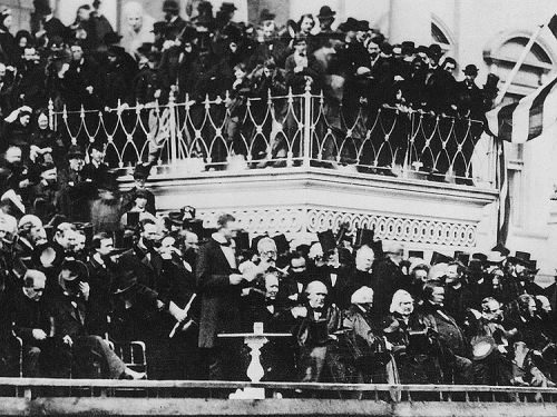 "Continuing Same Quote: ...""I answer, if it ever reach us it must spring up amongst us; it cannot come from abroad. If destruction be our lot we must ourselves be its author and finisher. As a nation of freemen we must live through all time, or die by suicide."" (Photo of President Lincoln as He Delivers His Second Inauguration Address)"